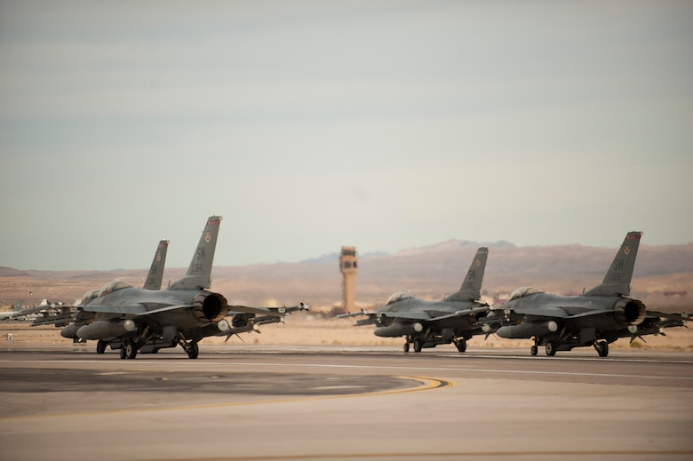 Four F-16 Fighting Falcons from the 55th Fighter Squadron, Shaw Air Force Base, S.C., prepare takeoff after end-of-runway checks for a training mission Jan. 29, 2014, at Nellis Air Force Base, Nev. The 55th FS is here for Red Flag 14-1.  The exercise incorporates all spectrums of warfare to include command and control, real-time intelligence, analysis and exploitation, and electronic warfare to prepare pilots and air support operations service members for future conflicts or war. Night missions have also been added to the exercise. (U.S. Air Force photo by Airman 1st Class Joshua Kleinholz)