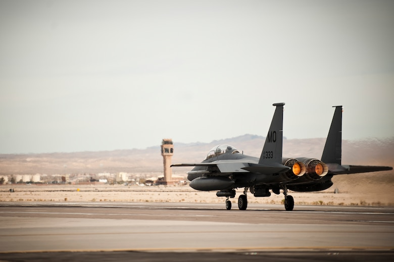 An F-15E Strike Eagle from the 391st Fighter Squadron, Mountain Home Air Force Base, Idaho, fires the afterburner prior to taking off for a training mission Jan. 29, 2014, at Nellis Air Force Base, Nev. During Red Flag exercises, the Air Force's 2.9 million acre Nevada Test and Training Range plays host to multiple simulated air wars that provide the most realistic training possible for U.S. and coalition pilots. (U.S. Air Force photo by Airman 1st Class Joshua Kleinholz)