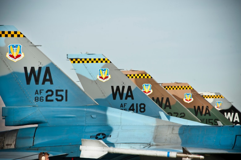 Five F-16 Fighting Falcons assigned to the 64th Aggressor Squadron await an end-of- runway inspection during Red Flag 14-1 Jan. 24, 2014, at Nellis Air Force Base, Nev. The Aggressors put the participants through their paces in air, space and cyberspace. Red Flag was established in 1975 to better prepare Airmen for combat missions because during Vietnam the kill ratio for U.S. pilots was two to one with many of them being shot down during their first 10 combat missions. (U.S. Air Force photo by Lorenz Crespo)