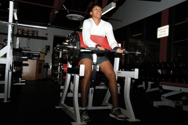 Cpl. Candice Clark, supply administration, Marine Corps Systems Command, works out seven day a week at the Daniels Family Fitness Center, recently. Clark achieved a perfect score, 300, on both the physical fitness test and combat fitness test.