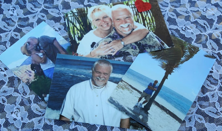 A collage of photos of Alison Miller and her late husband, retired Master Sgt. Chuck Dearing, are displayed on a table Jan. 16, 2014, at the Keesler Air Force Base camp site, Biloxi, Miss., while Miller is interviewed for an article about her traveling journey to honor their lives together. Following the couple's four year cross-country travel experience, Miller continues to travel as she spreads Dearing's cremains at their favorite destinations. (U.S. Air Force photo/Kemberly Groue)