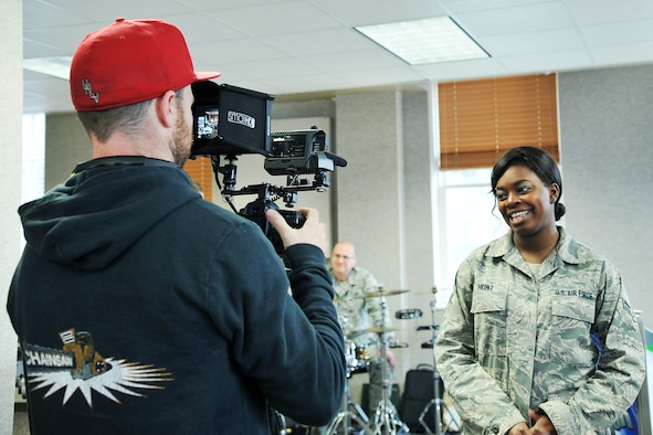 James Wright, a segment producer for American Idol, interviews Senior Airman Paula Hunt, a vocalist with the Heartland of America Band at Offutt Air Force Base, Neb., for the Omaha auditions episode of the show. Hunt appeared on the Jan. 30 episode of American Idol and received three yeses from the judges, ensuring her a ticket to Hollywood Week. (Photo by Charles Haymond)