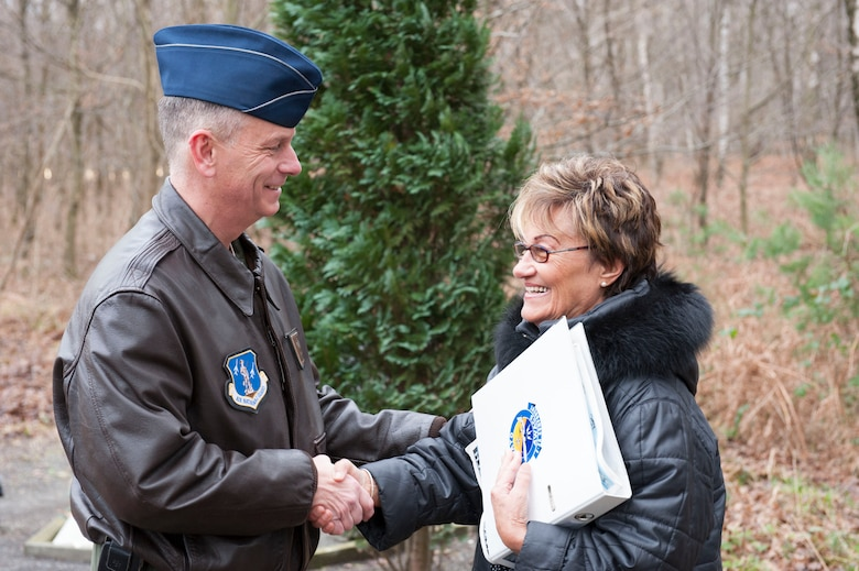 """U.S. Air National Guard Col. Daniel J. Swain, commander of the 141st Air Refueling Wing, thanks Else Kriska for the care she has provided to the erected memorial honoring the crew of """"ESSO 77"""" over the last 15 years in Geilenkirchen, Germany Jan. 9, 2014.. The memorial pays tribute to four 141st Air Refueling Wing Airmen who lost their lives in a KC-135E Stratotanker crash  Jan. 13, 1999."""