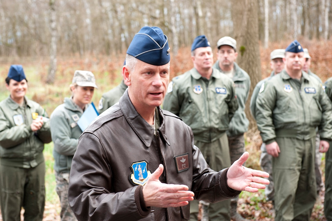 """U.S. Air National Guard Col. Daniel J. Swain, commander of the 141st Air Refueling Wing adresses  members during the 15 year memorial for the crash of  of """"ESSO 77"""" in Geilenkirchen NATO Air Base, Germany, Jan.10, 2014.  The crash cost the lives of four aircrew and a KC-135E stratotanker aircraft that was on a rotation to the NATO base to provide aerial refueling to NATO E3-A Sentry aircraft."""