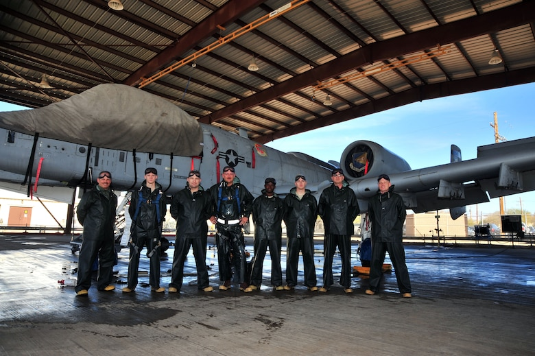 U.S. Air Force Airmen from the 355th Aircraft Maintenance Squadron pose for a photo with their leadership in front of an A-10C Thunderbolt at Davis-Monthan Air Force Base, Ariz., Jan. 28, 2014. The 355th AMXS  Leadership helped wash the aircraft after the squadron went 60 days without any safety or technical violations.(U.S. Air Force photo by Senior Airman Josh Slavin/released)