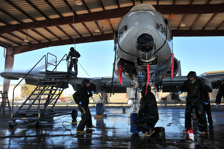 The 355th Aircraft Maintenance Squadron leadership work with their Airmen to wash an A-10C Thunderbolt at Davis-Monthan Air Force Base, Ariz., Jan. 28, 2014.  The Airmen use pressure washers with more than 3,000 pounds of pressure per square inch to clean the aircraft. (U.S. Air Force photo by Senior Airman Josh Slavin/released)