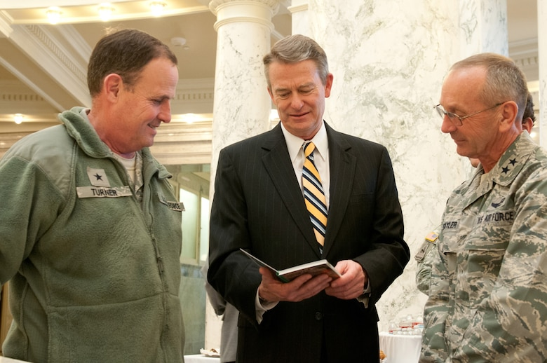 Idaho State Lt. Gov. Brad Little, middle, talks with Idaho National Guard Commanding General Maj. Gen. Gary Sayler, right, and Brig. Gen. Richard Turner, left, Assistant Adjutant General, Air, about construction for future facilities and the economic impact contributing to the economy during the Military Division Legislative Day held at the State Capitol building in Boise, Idaho Jan. 15. (Air National Guard photo by Master Sgt. Becky Vanshur)