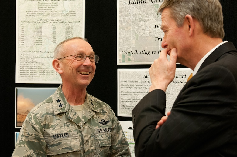 Idaho State Lt. Gov. Brad Little, right, talks with Idaho National Guard Commanding General Maj. Gen. Gary Sayler, about construction for future facilities and the economic impact contributing to the economy during the Military Division Legislative Day held at the State Capitol building in Boise, Idaho Jan. 15. (Air National Guard photo by Master Sgt. Becky Vanshur)
