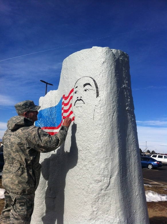 Staff Sgt. Alfonzo Martinez, 460th Logistics Readiness Squadron property manager, paints a mural of Dr. Martin Luther King Jr. in honor of Black History Month Jan. 21, 2014, on the spirit rock on Buckley Air Force Base, Colo. The spirit rock can be painted by all Team Buckley members wanting to highlight individuals, promote unit camaraderie or honor special observances.  (U.S. Air Force photo by Chief Master Sgt. Richard Halseth/Released)