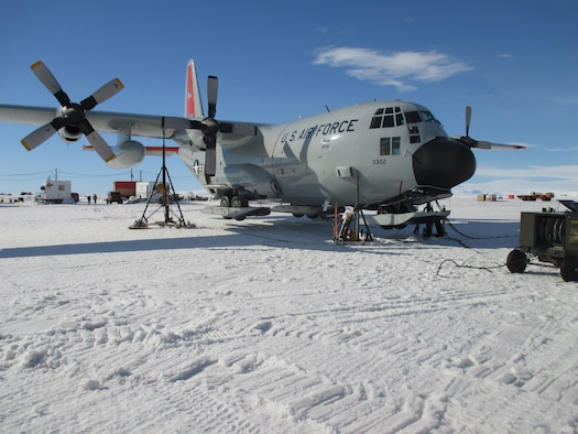 Pegasus Field, Antarctica - An LC-130 Skibird from the New York Air National Guard is jacked up on the frozen ice shelf of Pegasus field 16 Jan 2014 after aircrew discovered a landing gear issue.  The maintenance crews of the 109th Airlift Wing do not have hangars to work out of while deployed to Antarctica for Operation DEEP FREEZE and must work in the elements and handle unique challenges nearly every day.  (U.S. Air National Guard photo by Master Sgt. Kevin Phillips/Released)
