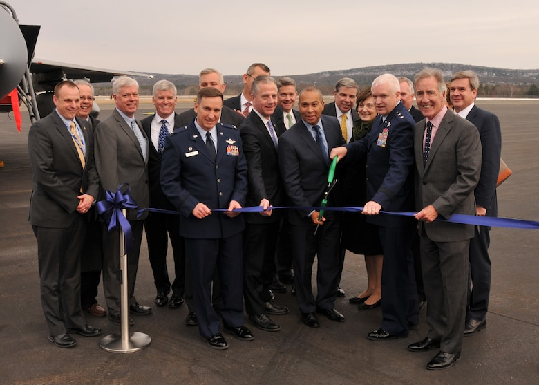 Massachusetts Governor Deval Patrick, U.S. Representative Richard Neal, Maj. Gen. L. Scott Rice, The Adjutant General, Massachusetts National Guard, Col. James J. Keefe, Commander 104th Fighter Wing, Massachusetts Air National Guard, and Brian Barnes, Westfield-Barnes Regional Airport Manager, participate in a runway upgrade ribbon cutting ceremony at Westfield-Barnes Regional Airport, Westfield, Mass. on Friday, Jan. 31, 2014. Fixing the runway was imperative for safe operations on both the military and civilian sides of the airport, and it took a strategic mix of funding resources from federal, state, and local government agencies to make it a reality.  Completion of this $21 million runway project fills a critical infrastructure need to the airfield jointly used by civilians, industry, and the military, which will help maintain and even increase the positive economic impact to the local area.  (U.S. Air National Guard photo by Senior Master Sgt. Robert J. Sabonis / Released).