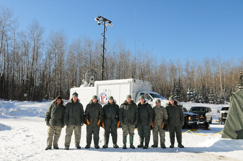 U.S. Airmen, 148th Fighter Wing, Communications Flight pose for a group photo at a remote location northwest of Grand Marais, Minn., Jan. 28, 2014.  The Airmen are part of the Deployable Interoperable Communications Element (DICE) team and were at the remote location to provide communication support for the John Beargrease sled dog marathon.  (U. S. Air National Guard photo by Master Sgt. Ralph J. Kapustka/Released)
