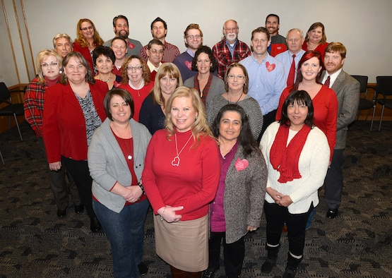 Sherri Sutterfield, a Contract Field Team Program manager, front, is happy to have the support of her co-workers in the Air Force Sustainment Center Contracting Directorate. Ms. Sutterfield has heart disease and now promotes heart health to anyone who will listen. She's a testament to getting checked by a physician and having a heart scan. Her scan saved her life.