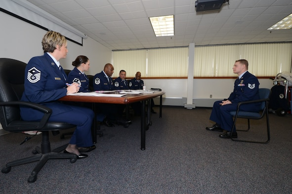 Tech Sgt. Brian Gilbert of the 103rd Maintenance Group answers questions from a board of First Sergeants during the annual Diamond Award selection process on January 1, 2014, at Bradley Air National Guard Base, East Granby, CT.  Once a year, the Connecticut Air National Guard's first sergeants present the Diamond Award to an individual who has shown a great deal of potential for future leadership, had a positive impact on his or her unit, and represents what the Air Force's core values.  (U.S. Air National Guard photo by Senior Airman Emmanuel Santiago)