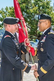 Brig. Gen. C. David Turner (right) passes the Corps of Engineers flag to incoming District Commander Lt. Col. John Morrow signaling the transfer of command responsibility during the change of command ceremony at the Bay Model Visitor Center, June 27, 2014.