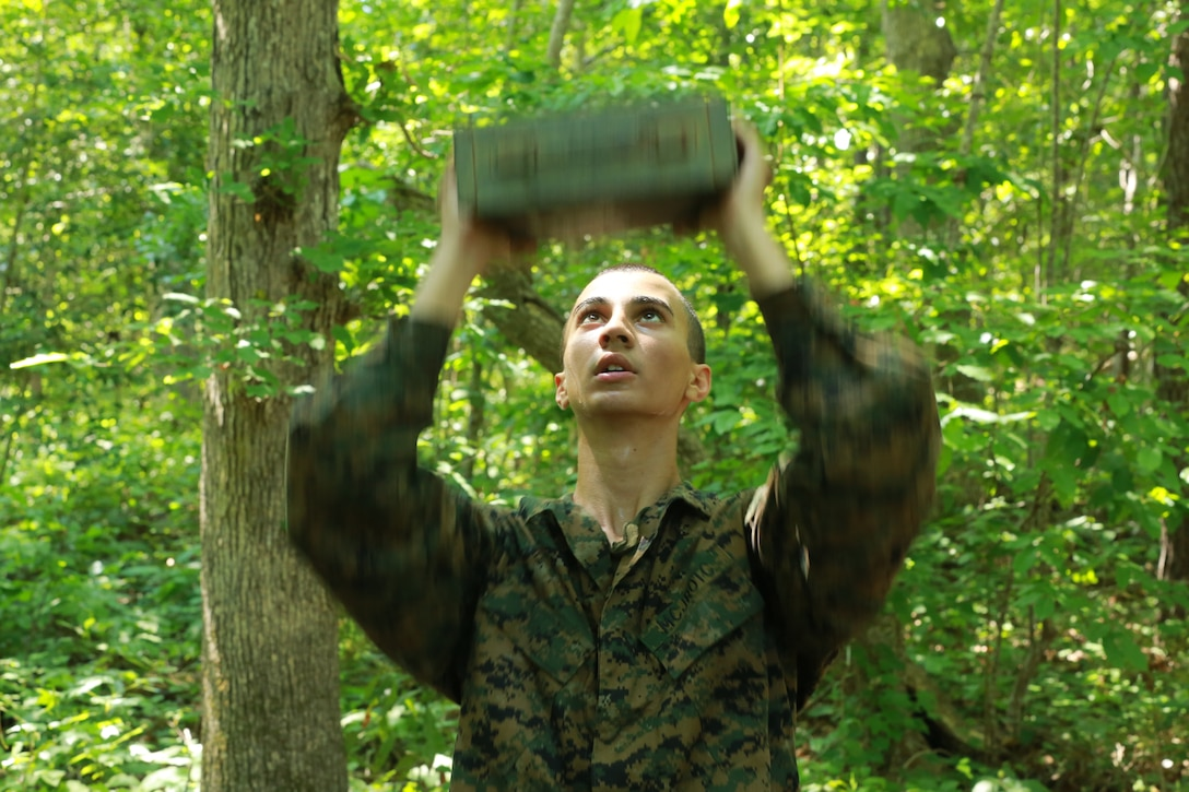 A Navy Junior Reserve Officers' Training Corps cadet completes an ammo can lift during an endurance course aboard Marine Corps Base Camp Lejeune, June 17. The cadets participated in a week-long exercise to experience the different aspects of the Corps.