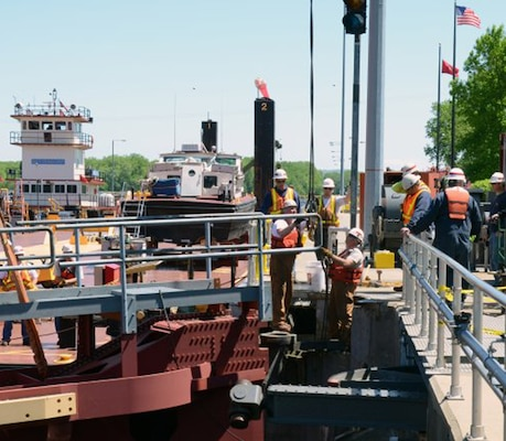 Crew members from St. Paul and Rock Islands districts install a temporary gate at Lock and Dam 5A, near Minnesota City, Minn., May 23, 2013. Since 2009, delays and interruptions have more than doubled on the nation's inland waterway locks and dams.