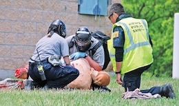 A Riley County tactical EMS team assesses a victim during active violence training June 12 at Victory Village. Several local agencies including K-State PD participated in the training.