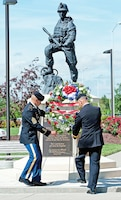 Command Sgt. Maj. Michael Grinston, left, and Maj. Gen. Paul E. Funk II, right, 1st Inf. Div. command team, lay a wreath in honor of fallen Soldiers during a June 12 ceremony at Victory Park.
