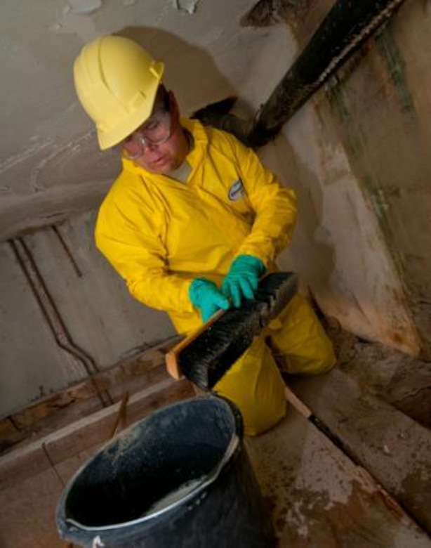 Chief Master Sgt. Kyle Johnson, 148th Civil Engineering Squadron, disinfects a bathroom wall at an elementary school in Ogulin, Croatia, June 19, 2014. The school bathrooms are being renovated by Airmen from the 133rd and 148th Civil Engineering Squadron, and 219th Red Horse Squadron in partnership with the Croatian Army, under the National Guard State Partnership Program. (U.S. Air National Guard photo by Staff Sgt. Austen Adriaens)