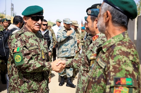 Afghan National Army (ANA) Gen. Shir Mohammad Karimi, chief of army staff, shakes hands with ANA officers, assigned to the 215th Corps, aboard Camp Shorabak, Helmand province, Afghanistan, June 27, 2014. Karimi visited with ANA leaders and ISAF advisors to discuss the military matters in the southwest region of Afghanistan. (Official U.S. Marine Corps photo by Lance Cpl. Darien J. Bjorndal, Marine Expeditionary Brigade Afghanistan/ Released)