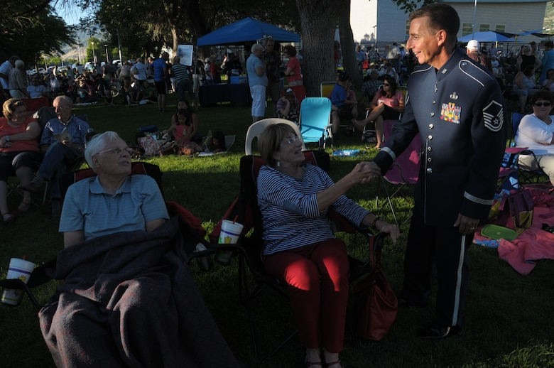 U.S. Air Force Master Sgt. Gerald Lockwood with the Air National Guard band of the West Coast talks to audience members at their performance in Bountiful City Park in Bountiful, Utah on June 30, 2014. (U.S. Air National Guard photo by Airman 1st Class Madeleine Richards/Released)