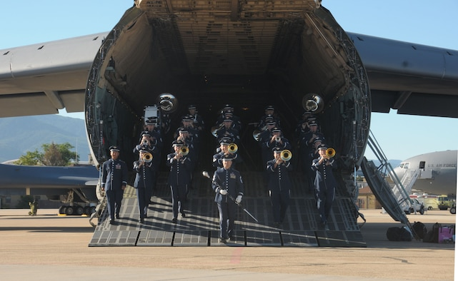 The Air National Guard Band of the West Coast marches out of a C-5 Galaxy at Hill Air Force Base in Layton, Utah on June 30, 2014. (U.S. Air National Guard photo by Airman 1st Class Madeleine Richards/Released)