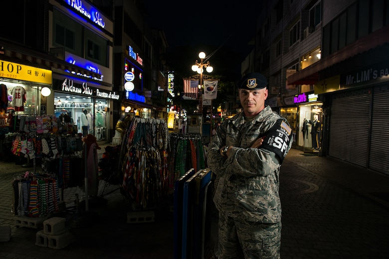 Tech. Sgt. Jason Winkle, 51st Security Forces Squadron town patrol NCO in charge, stands in the Songtan Entertainment District outside Osan Air Base, Republic of Korea, June 27, 2014. Members of town patrol prowl the streets of the SED during the hours of darkness to ensure the safety of service members and the general public. (U.S. Air Force photo/Staff Sgt. Jake Barreiro)