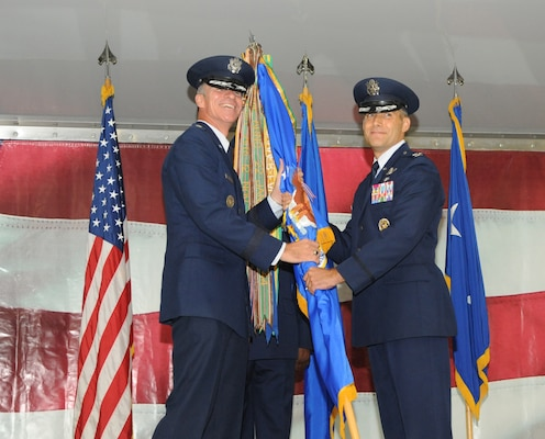 Col. Matthew C. Isler (right) accepts the 12 FTW guidon from Maj. Gen. Michael A. Keltz, Director of Intelligence, Operations and Nuclear integration Headquarters, Air Education and Training Command, Joint Base San Antonio-Randolph, Texas, during the Change of Command Ceremony June 25.  These ceremonies represent the formal passing of responsiblity, authority and accountablility of command from one officer to another. (U.S. Air Force photo by Melissa Peterson.