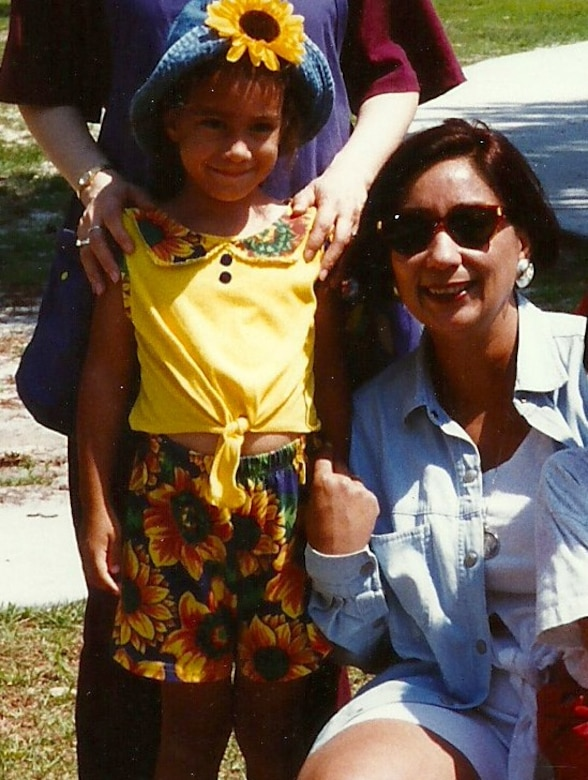 Sarah Stott and Nora Torres pose for a photo more than 20 years ago at the child development center on Hurlburt Field, Fla. Stott said Torres inspired her to work with children. (Courtesy photo)