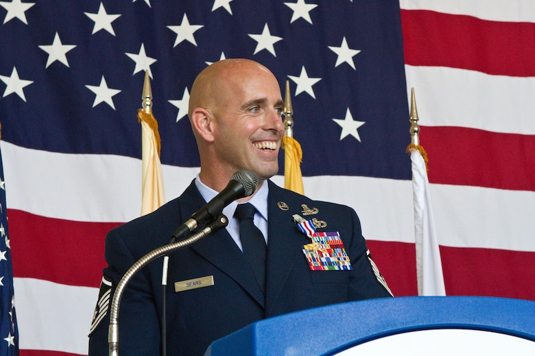 Silver Star recipient Master Sgt. Michael F. Sears, 177th Fighter Wing, addresses National Guard Bureau and New Jersey National Guard leadership, family, friends and fellow 177th Airmen June 28, 2014, at the 177th Fighter Wing in Egg Harbor Township, N.J. He received the Silver Star, the third highest military award, for actions while deployed to Afghanistan on Sept. 29, 2012. On that day, a three-man Air Force explosive ordnance disposal team led by Sears found itself in the middle of a complex ambush in Ghazni province, Afghanistan. During the course of a two-hour firefight, Sears provided life-saving aid to a fallen coalition soldier from Poland, ran five times through a 150-yard open area riddled with enemy machine gun fire to direct his team in returning fire, and continued on with the fight after being knocked temporarily unconscious by a rocket-propelled grenade blast. Sears joins a group of 58 Airmen who have been awarded the Silver Star since the Global War on Terrorism began. (U.S. Air National Guard photo by Master Sgt. Mark C. Olsen/Released)