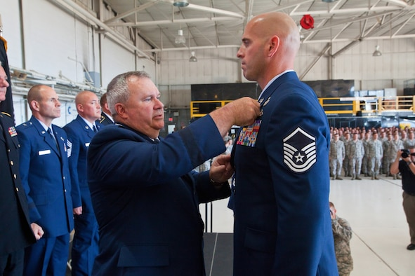 Brig. Gen. Michael L. Cunniff, left, the adjutant general of New Jersey, presents Master Sgt. Michael F. Sears, 177th Fighter Wing, the Silver Star, the third highest military award, June 28, 2014, during a ceremony at the 177th at Egg Harbor Township, N.J., for actions while deployed to Afghanistan on Sept. 29, 2012. On that day, a three-man Air Force explosive ordnance disposal team led by Sears found itself in the middle of a complex ambush in Ghazni province, Afghanistan. During the course of a two-hour firefight, Sears provided life-saving aid to a fallen coalition soldier from Poland, ran five times through a 150-yard open area riddled with enemy machine gun fire to direct his team in returning fire, and continued on with the fight after being knocked temporarily unconscious by a rocket-propelled grenade blast. Sears joins a group of 58 Airmen who have been awarded the Silver Star since the Global War on Terrorism began. (U.S. Air National Guard photo by Master Sgt. Mark C. Olsen/Released)