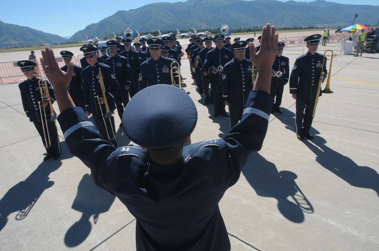 U.S. Air Force Capt. Vu Nguyen, commander of the 562nd Air Force Band of the West Coast prepares the band to perform the National Anthem at Hill Air Force Base in Layton, Utah on June 29, 2014. (U.S. Air National Guard photo by Airman 1st Class Madeleine Richards/Released)