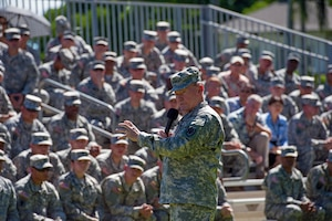 "Army Gen. Martin E. Dempsey, chairman of the Joint Chiefs of Staff, speaks with service members during a town hall on Fort Shafter, Hawaii, June 30, 2014. Dempsey told U.S. Army Pacific soldiers that he hopes the military services can retain their own unique field uniforms, adding that having separate military services brings perspectives to the table that are the epitome of ""jointness."" DoD photo by U.S. Navy Petty Officer 1st Class Daniel Hinton"