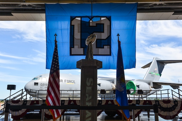 The Vince Lombardi Trophy sits upon a trophy case July 1, 2014, just before fans are let in to Hangar 9 during the 2014 Seattle Seahawks 12 Tour at Joint Base Lewis-McChord, Wash. The trophy was awarded to the Seahawks after winning Super Bowl XLVIII earlier this year. (U.S. Air Force photo/Staff Sgt. Russ Jackson)