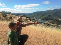 USACE Park Ranger Joel Miller points out a landmark to his son Hudson while hiking along the North Slope Trail at Lake Sonoma June 26, 2014. The North Slope Trail at Lake Sonoma was designated a national recreation trail by the U.S. Department of the Interior.