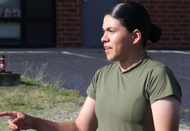 U.S. Marine Corps Pvt. Katherine L. Palacio, a recent recruit training graduate and Tucson, Ariz., native, leads poolees from Recruiting Sub-Station Greensboro, in physical training outside the sub-station's office in Greensboro, N.C., June 12, 2014. Palacio battled for four years to join the Marine Corps before enlisting out of Greensboro, N.C., on Feb. 20, 2014, and finishing recruit training as part of platoon 4018, O Company, 4th Recruit Training Battalion, Marine Corps Recruit Depot Parris Island, S.C., June 6, 2014. (U.S. Marine Corps photo by Sgt. Dwight A. Henderson/Released)
