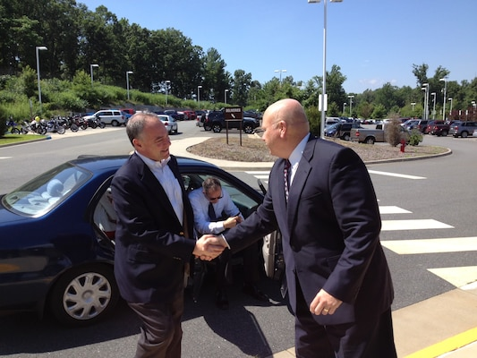 Rivanna Station Chief Thomas Francis greets Sen. Tim Kaine upon his arrival to the DIA facility.