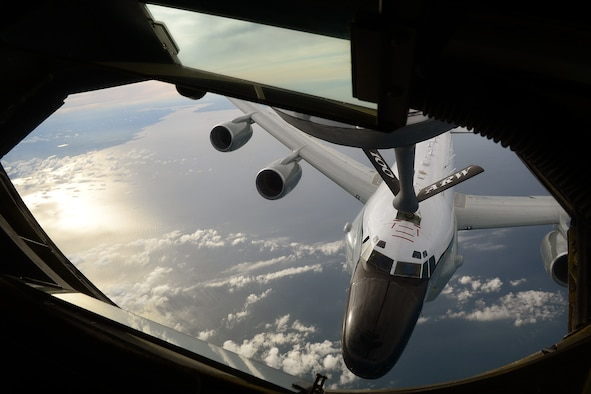 A KC-135 Stratotanker refuels a Royal Air Force RC-135V/W Rivet Joint June 26, 2014, off the coast of England. This was the first time a tanker belonging to the 100th Air Refueling Wing refueled a RAF RC-135. The KC-135 is based at RAF Mildenhall, England. (U.S. Air Force photo/Airman 1st Class Jonathan Light)