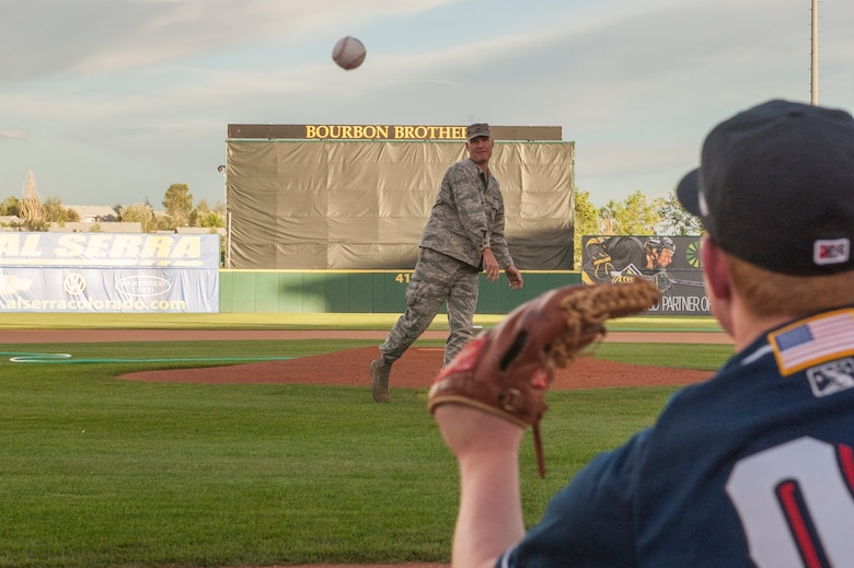 Col. Michael Hough throws out the first pitch during the second game of a doubleheader June 26, 2014, at the Colorado Springs Sky Sox Military Appreciation event in Colorado Springs, Colo. The Sky Sox lost the first game to the Iowa Cubs, but won the second game 7-6. Hough is the 21st Space Wing vice commander. (U.S. Air Force photo/Philip Carter)