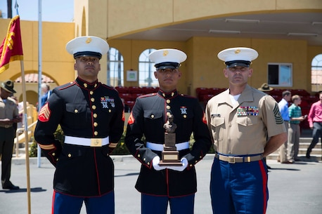 Sgt. Matthew S.Earle, left, recruiter, from Marine Corps Recruiting San Mateo, CA, Lance Cpl. Lawrence Liechty, middle, Company F Honorman, and Sgt. Maj. Larry Liechty, right, sergeant major, RS San Francisco, stand for a photo after graduation aboard Marine Corps Recruit Depot San Diego, June 13, 2014. Lance Cpl. Liechty graduated bootcamp as the Company F Honorman, a title only one Marine from each cycle can earn.