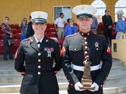 Lance Cpl. Jaymes Laughlin, right, poses for a photo with his recruiter Sgt. Julianna M. Pinder, RSS Antioch, after graduating from boot camp as the Company A honorman aboard Marine Corps Recruit Depot San Diego