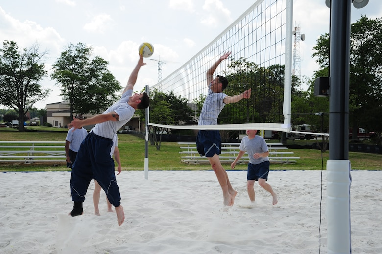Airmen enjoy their new volleyball court built for dorm residents at Joint Base Andrews, Md., during a friendly game of volleyball, June 26, 2014. (U.S. Air Force photo/Airman 1st Class Joshua R. M. Dewberry)