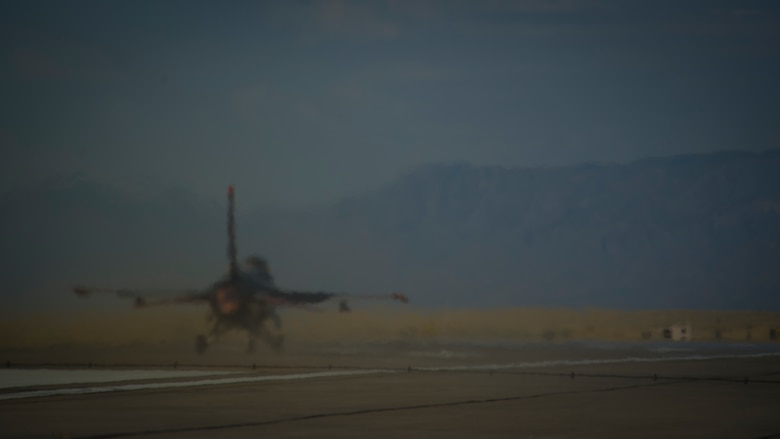 A QF-16 takes off during an unmanned live fire exercise at Holloman Air Force Base, N.M., June 25. A QF-16 took part in an operational live fire exercise as part of the aircrafts test flight program before the beginning of production at the Boeing facility in Cecil Field, Jacksonville, Fla. in late 2014. (U.S. Air Force photo by Airman 1st Class Aaron Montoya / Released)