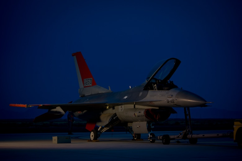 A QF-16 awaits a pre-flight inspection for an unmanned live fire exercise at Holloman Air Force Base, N.M., June 25. A QF-16 took part in an operational live fire exercise as part of the aircrafts test flight program before the beginning of production at the Boeing facility in Cecil Field, Jacksonville, Fla. in late 2014. (U.S. Air Force photo by Airman 1st Class Aaron Montoya / Released)