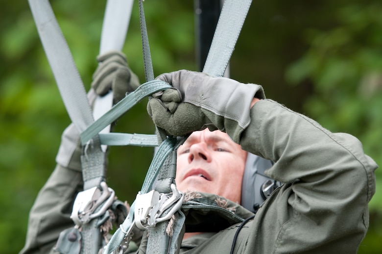 Col. Christan Stewart, a flight surgeon in the Kentucky Air National Guard, uses a Personnel Lowering Device while suspended from a Hanging Harness Trainer during survival training at Taylorsville Lake in Taylorsville, Ky., on June 5, 2014. More than 120 aircrew members from the Kentucky Air Guard completed land- and water-survival training here June 5 through 7. (U.S. Air National Guard photo by Master Sgt. Phil Speck)