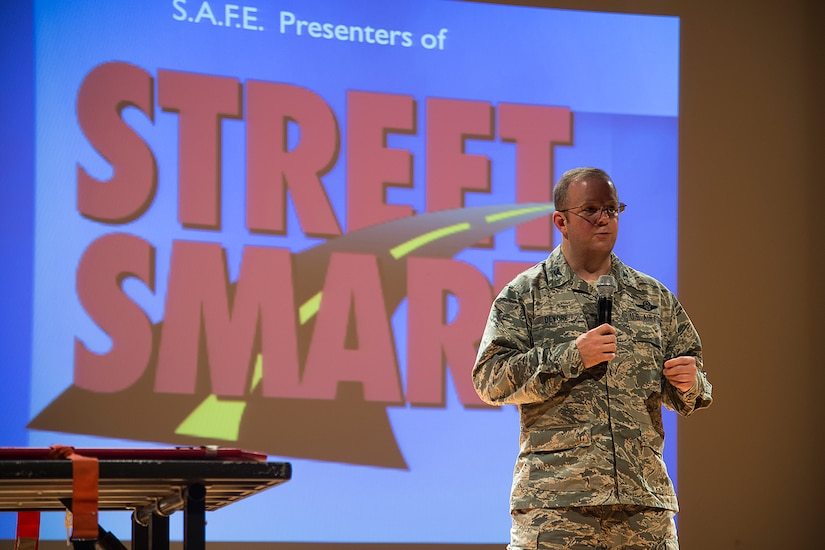 """Col. Jeffrey DeVore, Joint Base Charleston commander, introduces the Presentation, Stay Alive From Education """"Street Smart"""" program, at the Air Base Theater, June 28, 2014, at Joint Base Charleston, S.C. The program is an audience-interactive workshop designed for young adults, and offers attendees a real-life view of their options when confronted with possible life-changing choices. S.A.F.E. members took Airmen into the real-life drama experienced by firefighters and paramedics as they work to save the lives of individuals who have made poor choices when it comes to drinking and driving, using drugs or not wearing seat belts. (U.S. Air Force photo/Tech. Sgt. Rasheen Douglas)"""
