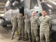 Staff Sgt. Matthew Tidball, (Second from right) 509th Logistics Readiness Squadron fuels hydrants supervisor, poses with members of his three level course in front of a MH-53 Pave Low helicopter at Lackland Air Force Base, Texas. The three level course was one of five courses Tidball has to complete for training. (Courtesy Photo)