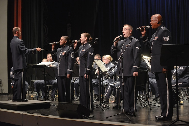 Members of the  531st Air Force Band, Band of the Southwest, Air National Guard, sing patriotic songs to the local community audiences at Bossier Parish Community College, Bossier City, Louisiana, June 25, 2014. The band's summer tour includes nine venues spread out between locations in Arkansas and Louisiana. (Air National Guard photo by Master Sgt. Charles Hatton/Released)