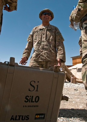 Army Sgt. Fabricio Granados jokes with fellow soldiers after fixing a generator on Forward Operating Base Sweeney, Afghanistan, June 19, 2014. U.S. Army photo by Staff Sgt. Whitney Houston